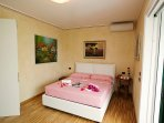 Comfortable bed with air-conditioning unit for the warm summer nights.