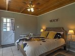 The master boasts a comfortable queen bed with views of Lake Travis across the street.