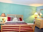oversized childrens room with toys and queen bed plus floor mattress