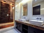 Master bathroom with dual vanities and oversized shower