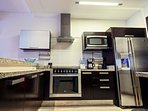 Gourmet kitchen with top line appliances and new dishwasher