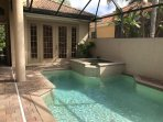 Pool in Courtyard as you walk into my home.  The French doors in pic lead to the cabana room