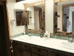 En suite master bath with dual sinks.
