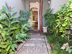 Welcoming entry with lovely Hawaiian landscaping.