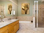 The luxurious master bath has dual sinks, a large walk in shower, and jetted tub