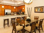 Ample seating for all guests in an inviting dining area with bar stools.