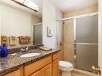 The upstairs bath has also been upgraded with granite countertops and has a tiled shower.