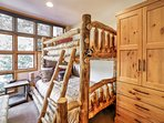 The second bedroom features a twin-over-full bunk bed.