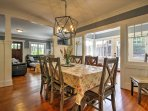 Serve dinner at the dining room table that can expand to fit up to 10 people.