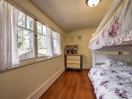 The Girls Room includes a twin-over-twin bunk bed and trundle bed.