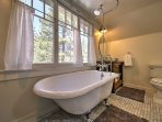 Sink into steamy waters of the luxurious claw foot tub.