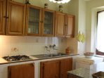 The kitchen is large by European standards and has all amenities including a Whirlpool fridge.