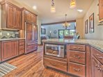 Fully Upgraded Kitchen with Stainless Steel Appliances, High-end Finishes, Granite Countertops and Bar Seating