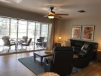 Living room: Couch, Recliners- Flat Screen Top of the Line TV-DVD/Beautiful view of the Pool