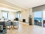 The main living room of the first floor has a balcony with sea and pool views!