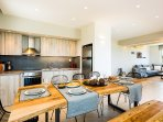 The main kitchen  of the first floor also has dining table ideal for the family!