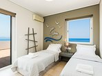 The second bedroom of the second floor has amazing sea views!