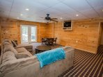 Lower level TV and game room with access to outside deck area.
