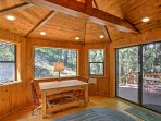 The sunroom off the master bedroom offers direct access to the porch.