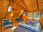 The loft comes complete with a queen bed and 2 twin beds.