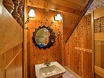 This half bathroom can be found off the loft.