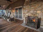 The front porch has a wood burning fireplace and comfortable wicker seating .