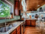 Open kitchen perfect for entertaining and views of the mountains.