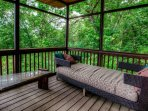 Day bed in screened in porch just off Master Bedroom.
