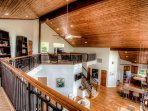 Open view of great room from upper level landing.