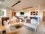 Game Room on lower level with foosball and air hockey. Entertainment center with inside and exterior Bose speaker...