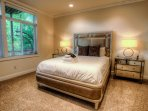 Lower level bedroom with Queen bed and access to outside deck, hot tub and Zen Garden.