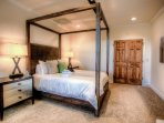 Lower level bedroom with Queen Bed &  Day Bed plus view of water feature gardens and mountains.