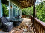 Lower level deck with flagstone and hot tub.