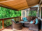 Seating area on back deck with electrical retractable awning.