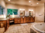 Master bathroom with silk flower arrangements by Flowers by Larry a local artist in Hendersonville.