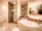 Relaxing master bathroom with soaking tub. Rain shower and massaging cascading head and a European handle shower head.