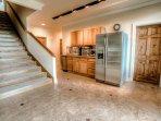 Downstairs mini kitchen with large Whirlpool fridge, pop corn maker, Sharp Carousel microwave and Keurig coffee maker...