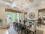 Dining Room with Coffered Ceilings & Courtyard View