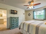 In the second bedroom, you'll find a queen-sized bed and a flat-screen cable TV.