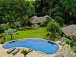 Infinity Pool, lush gardens and Pavilions Samba(left) and Rumba