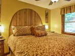 Those sharing the master bedroom will enjoy restful nights of sleep in this plush king bed.