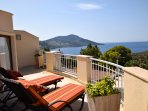 Roof terrace with a view and sun loungers