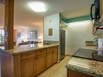 Updated kitchen with granite counter tops and stainless steel appliances
