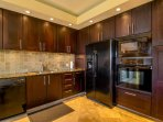 Fully equipped kitchen is perfect for dining in