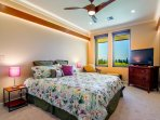 Second upstairs bedroom with custom ceiling fan and wood lighting feature