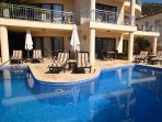 Main pool and terrace with loungers and outside dining