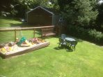 kiddies sandpit in rear garden