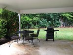 Quiet outdoor eating area with gas grill
