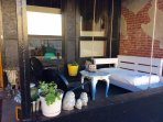 Our patio space is small but inviting, enjoy a cup of Joe or Glass of wine or my fav, a Martini