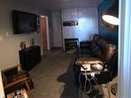 Private media room, reclining couch, Flat Screen DirecTV, and Amazon Fire Stick, w/propane fireplace